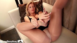 In order to get him hard, she used her pretty feet on a sex toy
