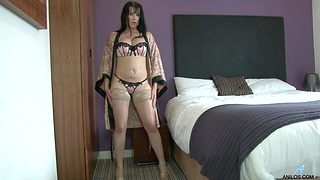 Solo cougar Tanya Cox opens her legs to masturbate on the bed