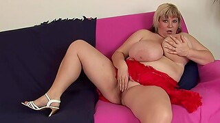 Chubby slut Juliana B. moans while bringing off with a red intrigue b passion toy
