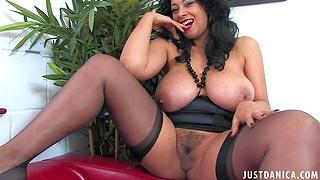 Naughty cougar Danica Collins enjoys flashing her giant boobs